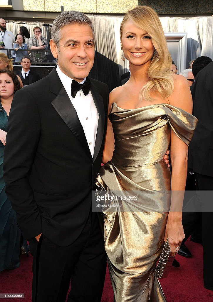 George Clooney and Stacy Keibler arrives at the 84th Annual Academy Awards at Grauman's Chinese Theatre on February 26, 2012 in Hollywood, California.