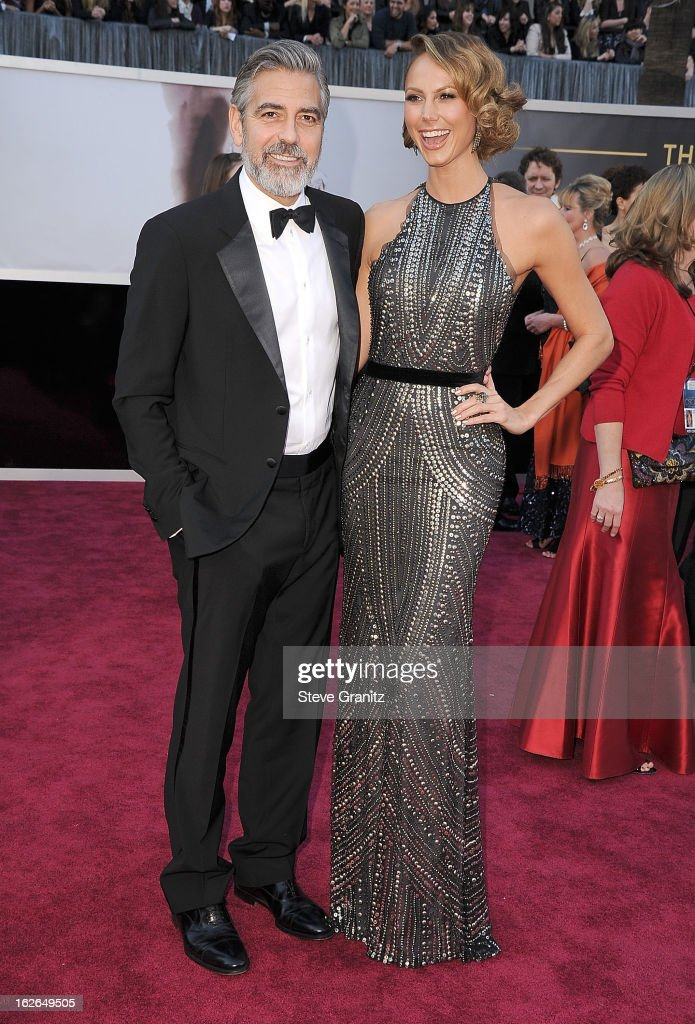 George Clooney and Stacy Keibler arrives at the 85th Annual Academy Awards at Dolby Theatre on February 24, 2013 in Hollywood, California.