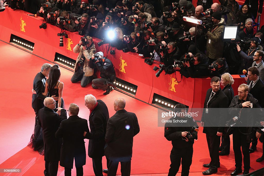 <a gi-track='captionPersonalityLinkClicked' href=/galleries/search?phrase=George+Clooney&family=editorial&specificpeople=202529 ng-click='$event.stopPropagation()'>George Clooney</a> and wife Amal Clooney attend the 'Hail, Caesar!' premiere during the 66th Berlinale International Film Festival Berlin at Berlinale Palace on February 11, 2016 in Berlin, Germany.
