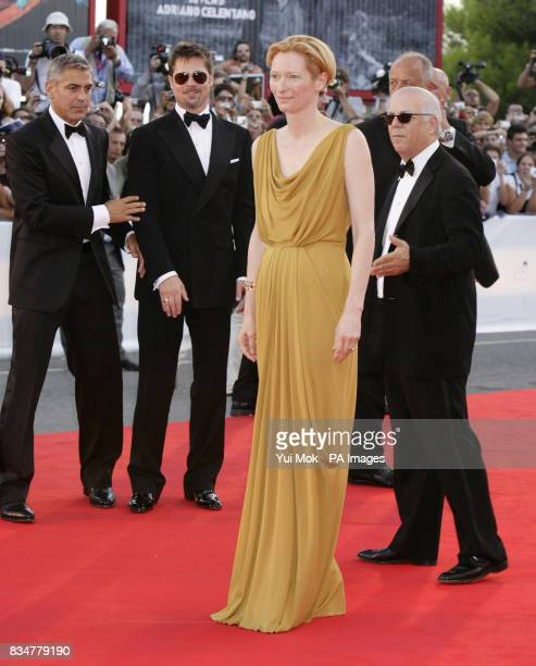 George Clooney Brad Pitt and Tilda Swinton attend the opening night screening for Burn After Reading at the 65th Venice Film Festival Venice Italy