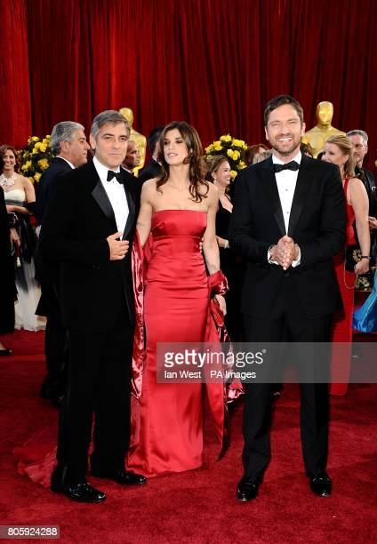 George Clooney Elisabetta Canalis and Gerard Butler arriving for the 82nd Academy Awards at the Kodak Theatre Los Angeles
