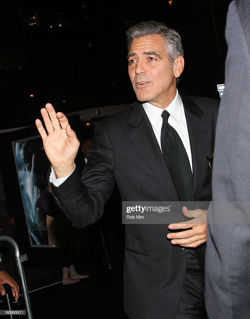 <a gi-track='captionPersonalityLinkClicked' href=/galleries/search?phrase=George+Clooney&family=editorial&specificpeople=202529 ng-click='$event.stopPropagation()'>George Clooney</a> greets fans during arrivals for the 'Gravity' premiere at AMC Lincoln Square Theater on October 1, 2013 in New York City.
