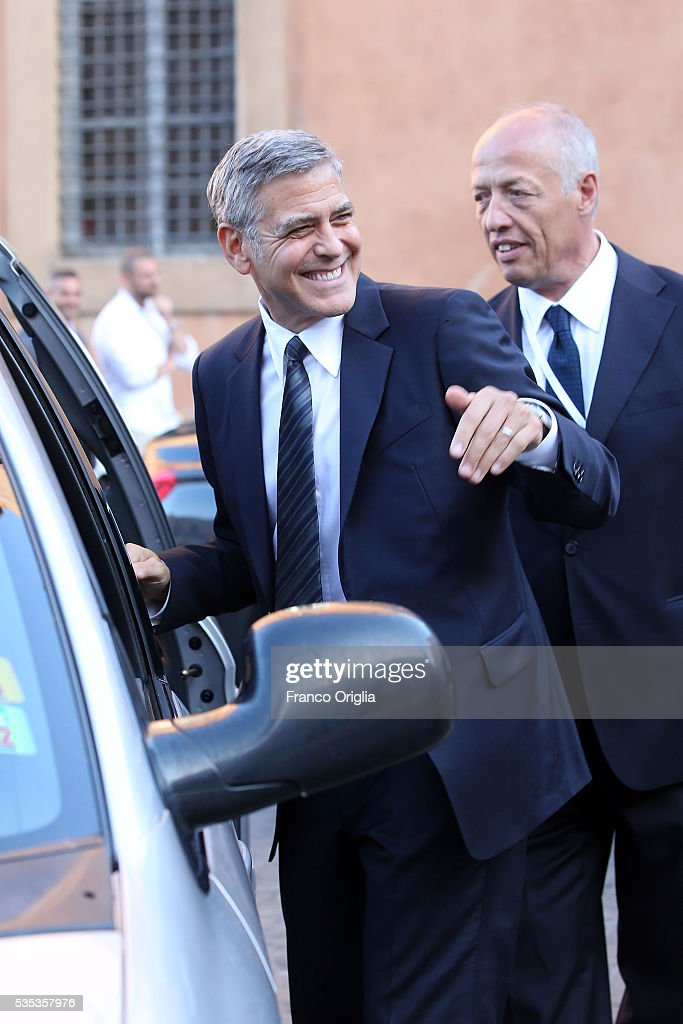<a gi-track='captionPersonalityLinkClicked' href=/galleries/search?phrase=George+Clooney&family=editorial&specificpeople=202529 ng-click='$event.stopPropagation()'>George Clooney</a> leaves at the end of 'Un Muro o Un Ponte' Seminary held by Pope Francis at the Paul VI Hall on May 29, 2016 in Vatican City, Vatican.