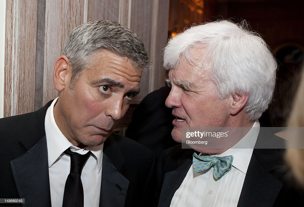<a gi-track='captionPersonalityLinkClicked' href=/galleries/search?phrase=George+Clooney&family=editorial&specificpeople=202529 ng-click='$event.stopPropagation()'>George Clooney</a>, left, and Bloomberg executive editor Al Hunt attend the Bloomberg Vanity Fair White House Correspondents' Association (WHCA) dinner afterparty in Washington, D.C., U.S., on Saturday, April 28, 2012. The 98th annual dinner raises money for WHCA scholarships and honors the recipients of the organization's journalism awards. Photographer: Joshua Roberts/Bloomberg via Getty Images