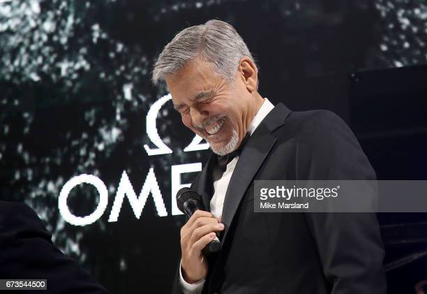 George Clooney on stage at the OMEGA 'Lost In Space' dinner to celebrate the 60th anniversary of the OMEGA Speedmaster which has been worn by every...