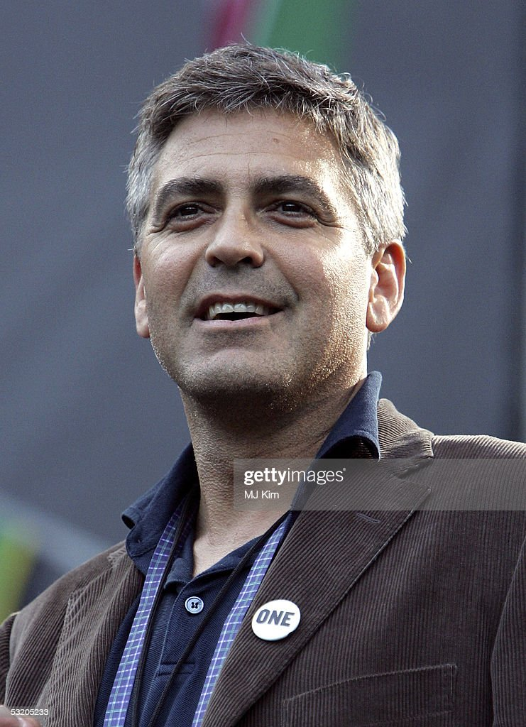 George Clooney performs on stage at the Live 8 Edinburgh concert at Murrayfield Stadium on July 6, 2005 in Edinburgh, Scotland. The free gig, labelled Edinburgh 50,000 - The Final Push, is organised by Midge Ure, alongside Geldof, and coincides with the G8 summit to raisie awareness for MAKEpovertyHISTORY.