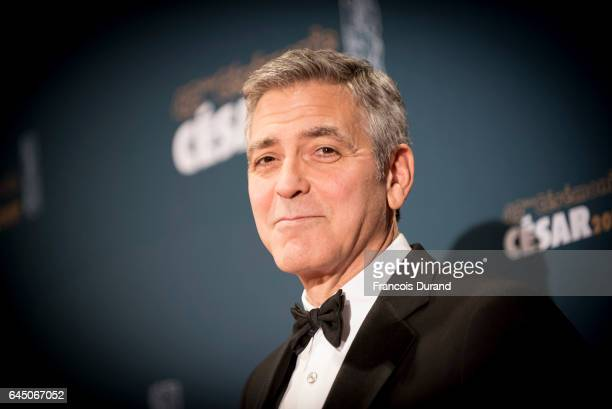 George Clooney poses with CESAR honorary award during the Cesar Film Awards 2017 at Salle Pleyel on February 24 2017 in Paris France