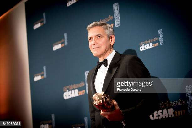 George Clooney poses with the Cesar honorary award during the Cesar Film Awards 2017 at Salle Pleyel on February 24 2017 in Paris France
