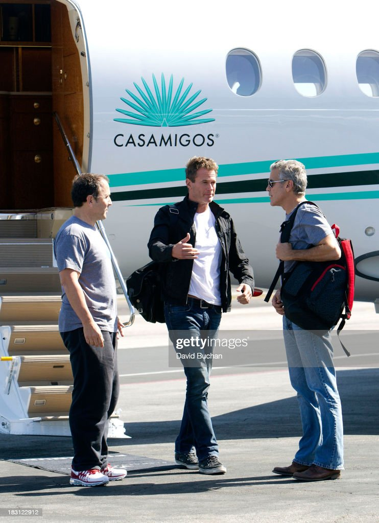 George Clooney, Rande Gerber and Mike Meldman Landing on their Casamigos Tequila Plane after attending the NY 'Gravity' Premiere at the Van Nuys Airport on October 4, 2013 in Van Nuys, California.