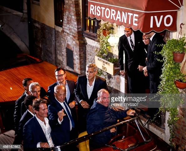 George Clooney rides in a boat as he leaves the restaurant Da Ivo with friends and his father during his stag night event in Venice on September 27...