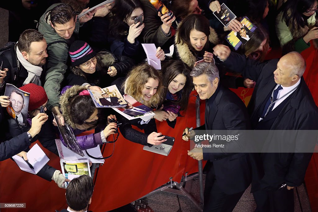 <a gi-track='captionPersonalityLinkClicked' href=/galleries/search?phrase=George+Clooney&family=editorial&specificpeople=202529 ng-click='$event.stopPropagation()'>George Clooney</a> sings autographs at the 'Hail, Caesar!' premiere during the 66th Berlinale International Film Festival Berlin at Berlinale Palace on February 11, 2016 in Berlin, Germany.