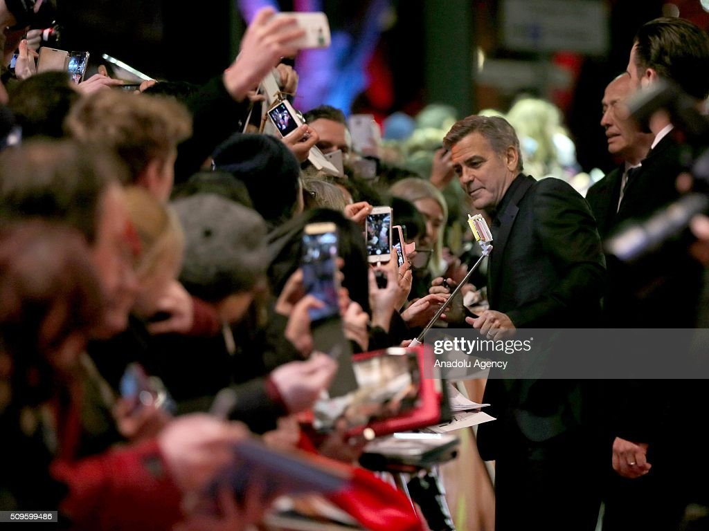 George Clooney sings autographs at the 'Hail, Caesar!' premiere during the 66th Berlinale International Film Festival Berlin at Berlinale Palace in Berlin, Germany on February 11, 2016.