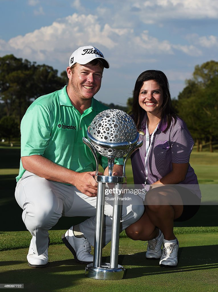 George Coetzee of South Africa and his girlfriend Carli Jeanne Pohl and the trophy for winning the Tshwane Open at Pretoria Country Club on March 15...