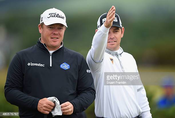 George Coetzee of South Africa and Louis Oosthuizen of South Africa in discussion during practice ahead of the 144th Open Championship at The Old...