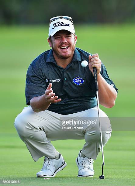 George Coetzee of South Africa catches a ball during the first round of AfrAsia Bank Mauritius Open at Four Seasons Golf Club Mauritius at Anahita on...