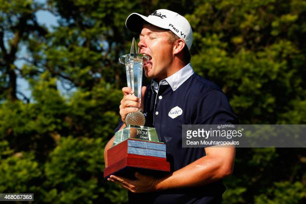 George Coetzee of South Africa celebrates with the trophy after winning the Joburg Open at Royal Johannesburg and Kensington Golf Club on February 9...