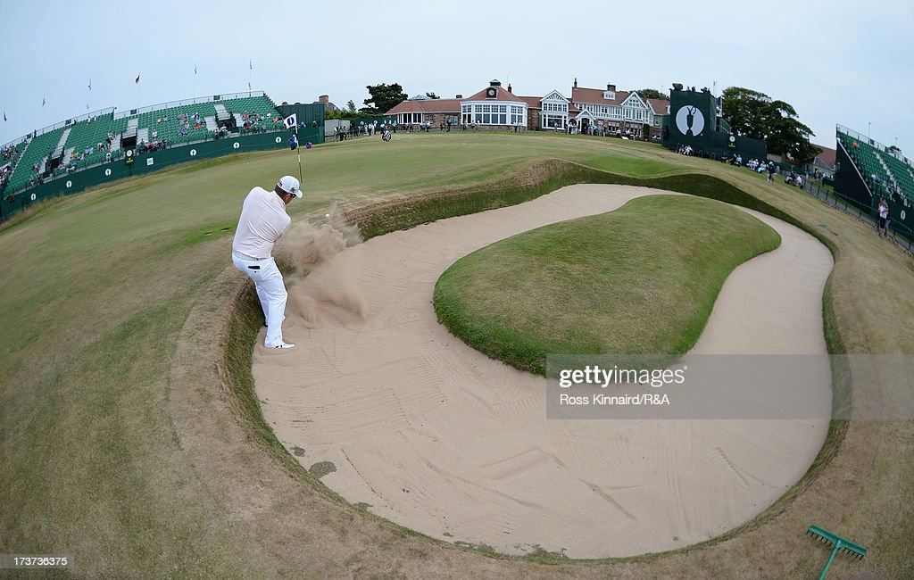 George Coetzee of South Africa hits from a bunker on the 18th hole ahead of the 142nd Open Championship at Muirfield on July 17, 2013 in Gullane, Scotland.