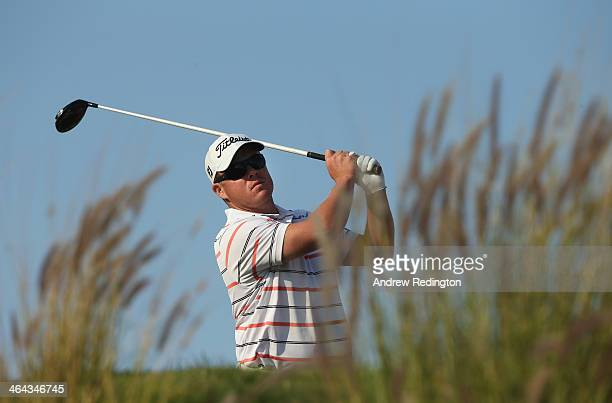 George Coetzee of South Africa hits his teeshot on the 16th hole during the first round of the Commercial Bank Qatar Masters at Doha Golf Club on...