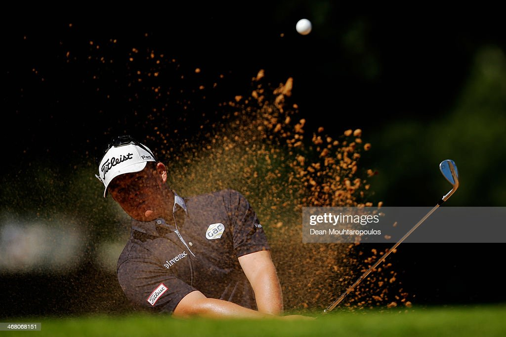 George Coetzee of South Africa hits his third shot on the 17th hole out of the bunker during the Final Round of the Joburg Open at Royal Johannesburg...