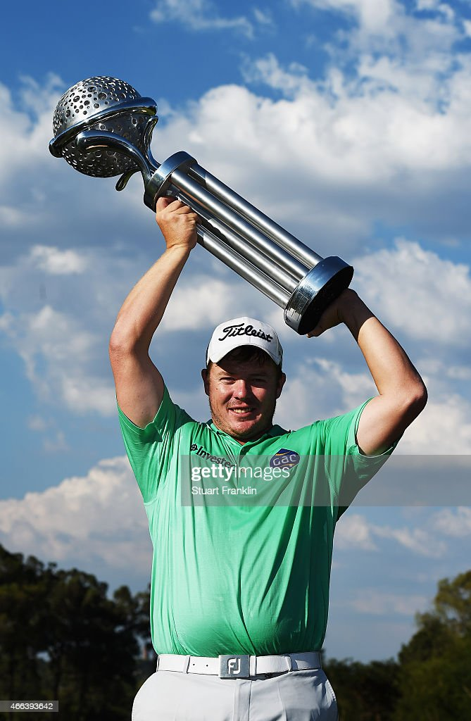 George Coetzee of South Africa holds the trophy for winning the Tshwane Open at Pretoria Country Club on March 15 2015 in Pretoria South Africa