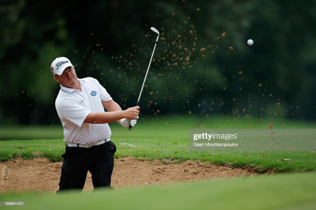 George Coetzee of South Africa in the bunker on the 8th East Course green during the Joburg Open ProAm at Royal Johannesburg and Kensington Golf Club on February 6, 2013 in Johannesburg, South Africa.