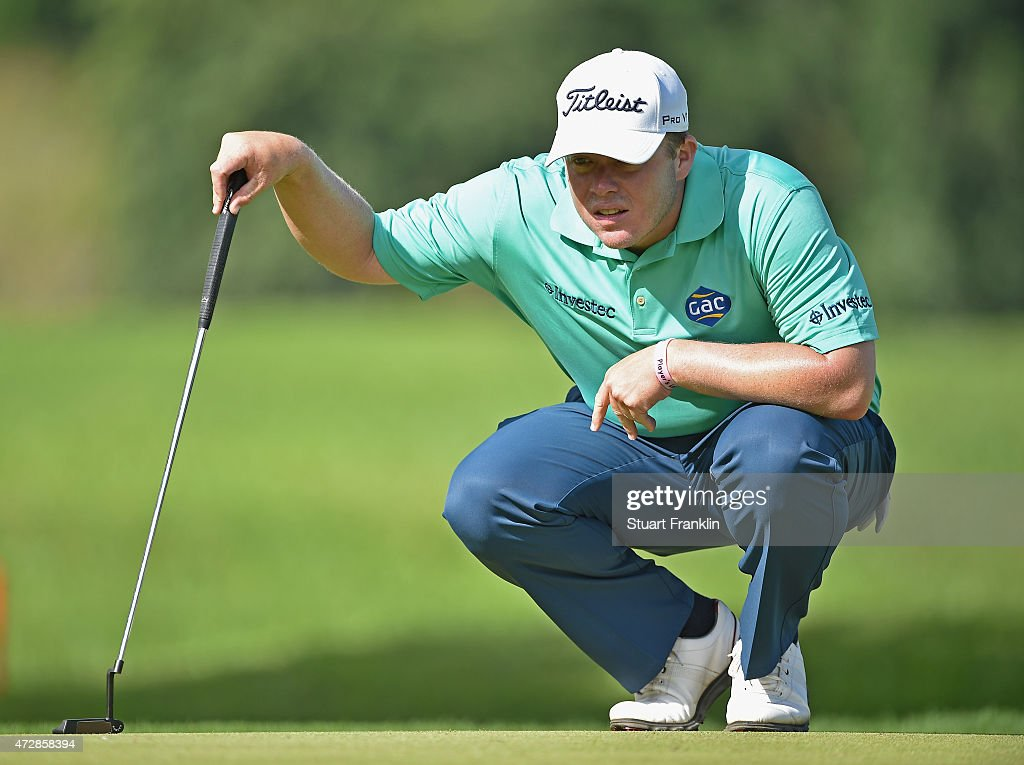 George Coetzee of South Africa lines up a putt during the final round of the AfrAsia Bank Mauritius Open at Heritage Golf Club on May 10 2015 in Bel...