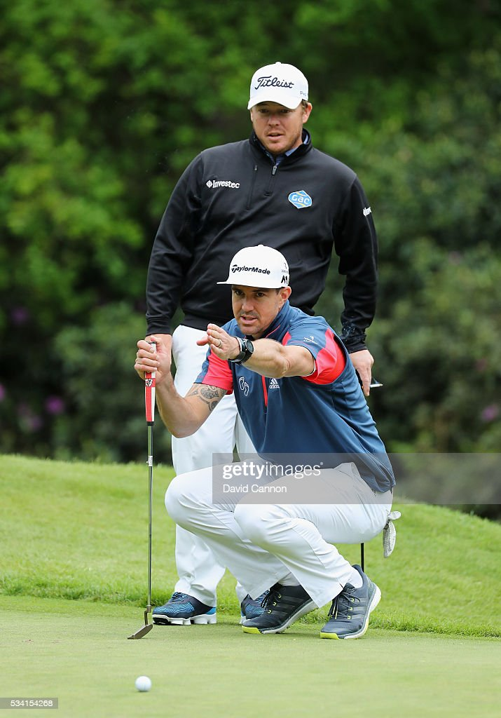 <a gi-track='captionPersonalityLinkClicked' href=/galleries/search?phrase=George+Coetzee&family=editorial&specificpeople=4687881 ng-click='$event.stopPropagation()'>George Coetzee</a> of South Africa lines up with Kevin Pietersen during the Pro-Am prior to the BMW PGA Championship at Wentworth on May 25, 2016 in Virginia Water, England.