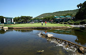 George Coetzee of South Africa Marcel Siem of Germany and Ross Fisher of England putt on the 9th green during the second round of the Nedbank Golf...