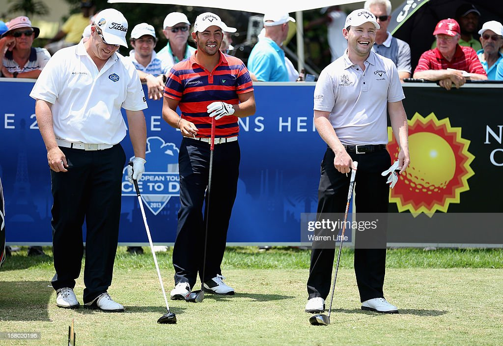 George Coetzee of South Africa, Pablo Larrazabal of Spain and Branden Grace of South Africa have a joke on the first tee during the second round of The Nelson Mandela Championship presented by ISPS Handa at Royal Durban Golf Club on December 9, 2012 in Durban, South Africa.