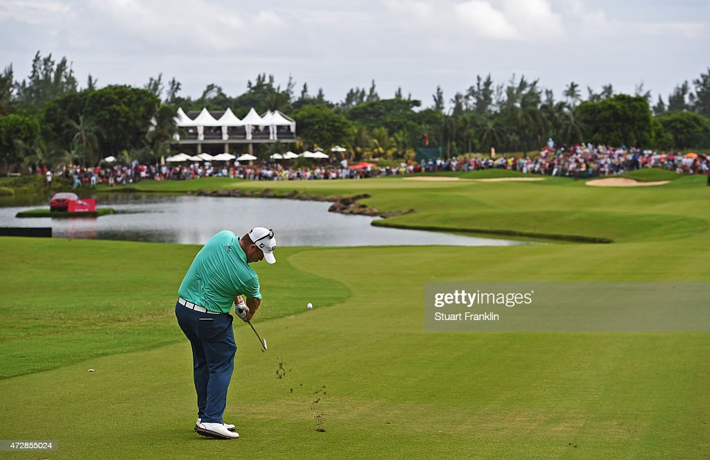George Coetzee of South Africa plays a shot on the 18th hole during the final round of the AfrAsia Bank Mauritius Open at Heritage Golf Club on May...