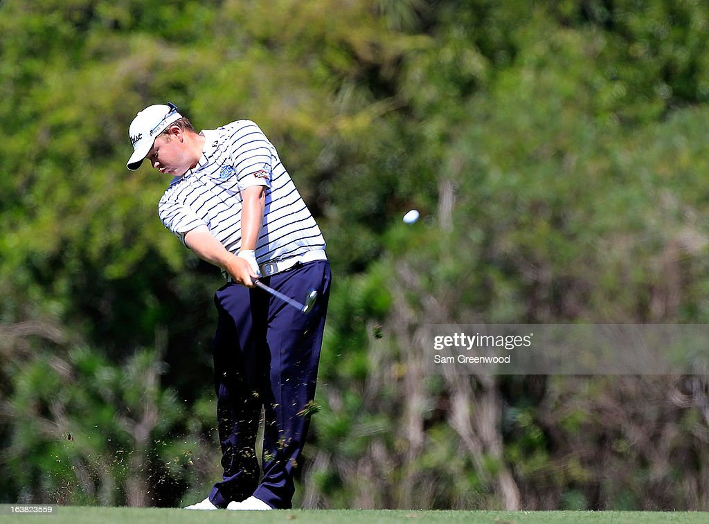 <a gi-track='captionPersonalityLinkClicked' href=/galleries/search?phrase=George+Coetzee&family=editorial&specificpeople=4687881 ng-click='$event.stopPropagation()'>George Coetzee</a> of South Africa plays a shot on the 7th hole during the third round of the Tampa Bay Championship at the Innisbrook Resort and Golf Club on March 16, 2013 in Palm Harbor, Florida.