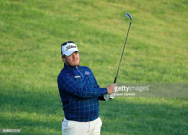 George Coetzee of South Africa plays his second shot at the par 5 10th hole during the second round of the 2016 Omega Dubai Desert Classic on the...
