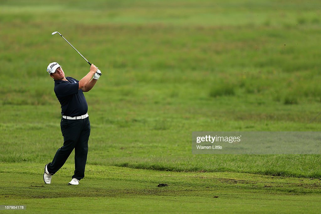 George Coetzee of South Africa plays his second shot into the 17th green during the first round of The Nelson Mandela Championship presented by ISPS Handa at Royal Durban Golf Club on December 8, 2012 in Durban, South Africa.