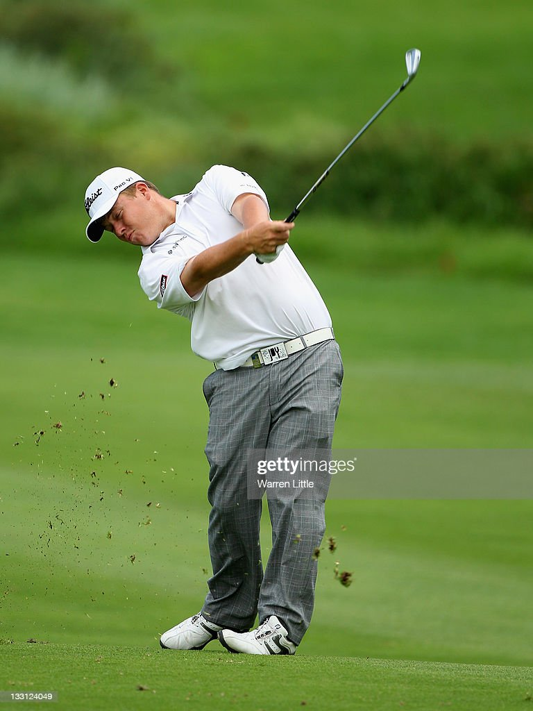George Coetzee of South Africa plays his second shot into the ninth green during the first round of the Alfred Dunhill Championships at Leopard Creek Golf Club on November 17, 2011 in Malelane, South Africa.