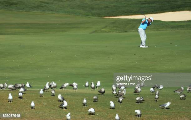 George Coetzee of South Africa plays his second shot on the 14th hole during day four of the Portugal Masters at Dom Pedro Victoria Golf Club on...