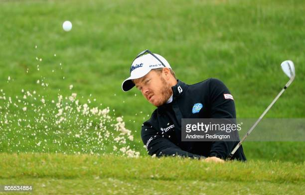 George Coetzee of South Africa plays out of a bunker on the practice ground during day four of the HNA Open de France at Le Golf National on July 2...