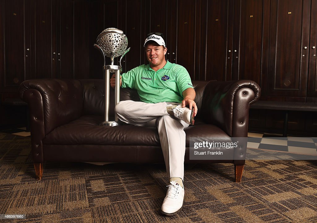 George Coetzee of South Africa poses for a picture with the trophy in the locker room after winning the Tshwane Open at Pretoria Country Club on...