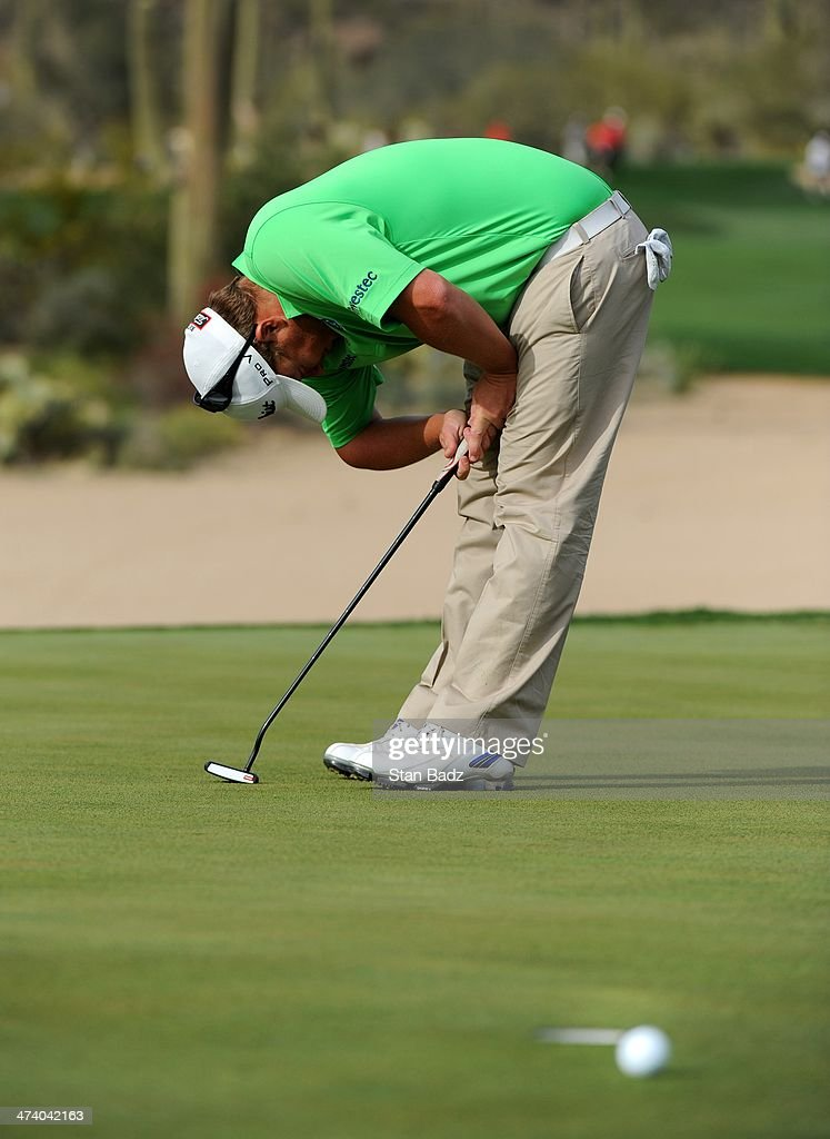 George Coetzee of South Africa reacts to his putt that ran past the cup on the 17th green during the third round of the World Golf Championships-Accenture Match Play Championship at The Golf Club at Dove Mountain on February 21, 2014 in Marana, Arizona.