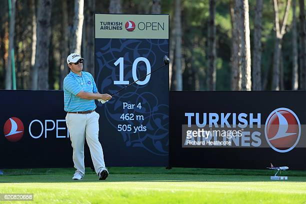 George Coetzee of South Africa tees off on the 10th hole during day one of the Turkish Airlines Open at the Regnum Carya Golf Spa Resort on November...