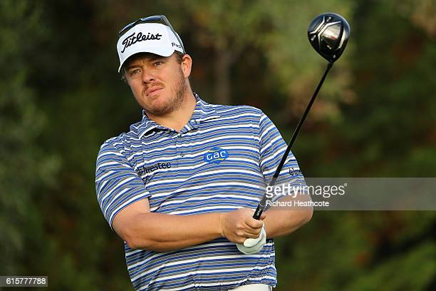 George Coetzee of South Africa tees off on the 12th hole during day one of the Portugal Masters at Victoria Clube de Golfe on October 20 2016 in...