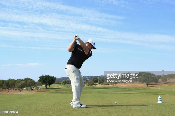 George Coetzee of South Africa tees off on the 3rd during day one of the 2017 Portugal Masters at Oceanico Victoria Golf Club on September 21 2017 in...