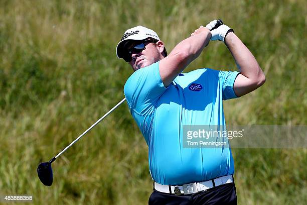 George Coetzee of South Africa watches his tee shot on the 14th hole during the first round of the 2015 PGA Championship at Whistling Straits on...