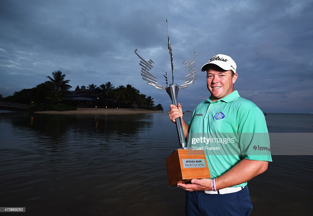 George Coetzee of South Africa with the trophy after winning the AfrAsia Bank Mauritius Open at Heritage Golf Club on May 10 2015 in Bel Ombre...