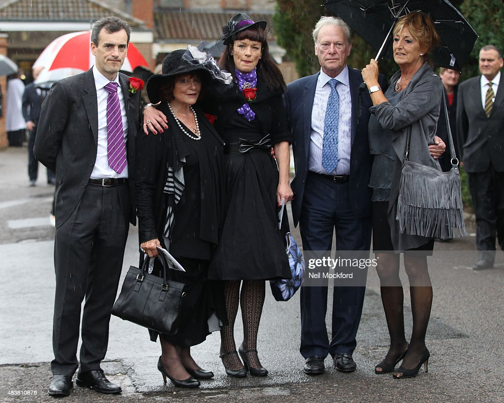 George Cole's son Toby, his wife Penny Morrell and daughter Tara Cole with <a gi-track='captionPersonalityLinkClicked' href=/galleries/search?phrase=Dennis+Waterman&family=editorial&specificpeople=223870 ng-click='$event.stopPropagation()'>Dennis Waterman</a> and his wife Pam Flint attend the funeral of George Cole at Reading Crematorium on August 13, 2015 in Reading, England.