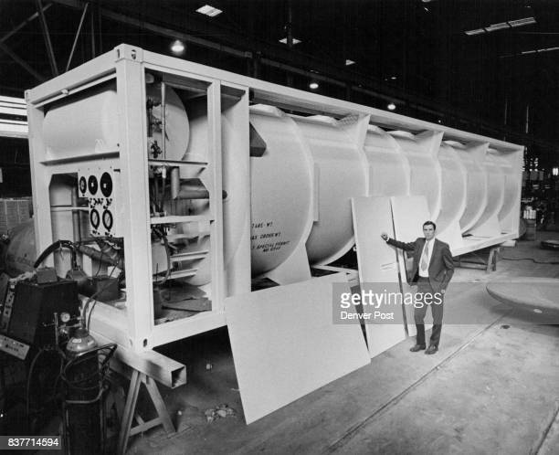 George Covington vice president of Cryogenic Engineering Co Denver who stands 64 is dwarfed by one of his firm's 8500gallon containers which could...