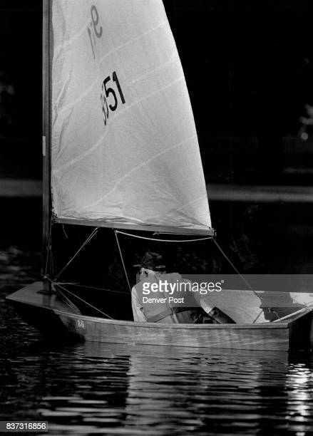 George Cox of Denver maneuvers his El Toro sailboat during a MileHi sailing club race at Grassmere Lake in Washington Park Races are held every...