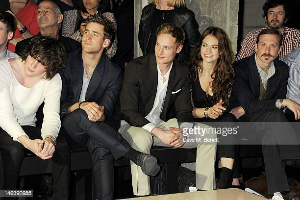 George Craig Oliver JacksonCohen Jack Fox Lily James and Tim Downie attend the Spencer Hart Spring/Summer 2013 catwalk show during London Collections...