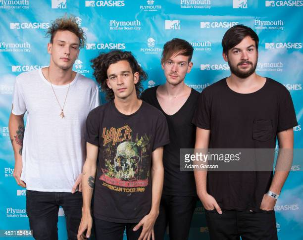 George Daniel Matt Healy Adam Hann and Ross McDonald of The 1975 pose before performing at MTV Crashes Plymouth at Plymouth Hoe on July 15 2014 in...