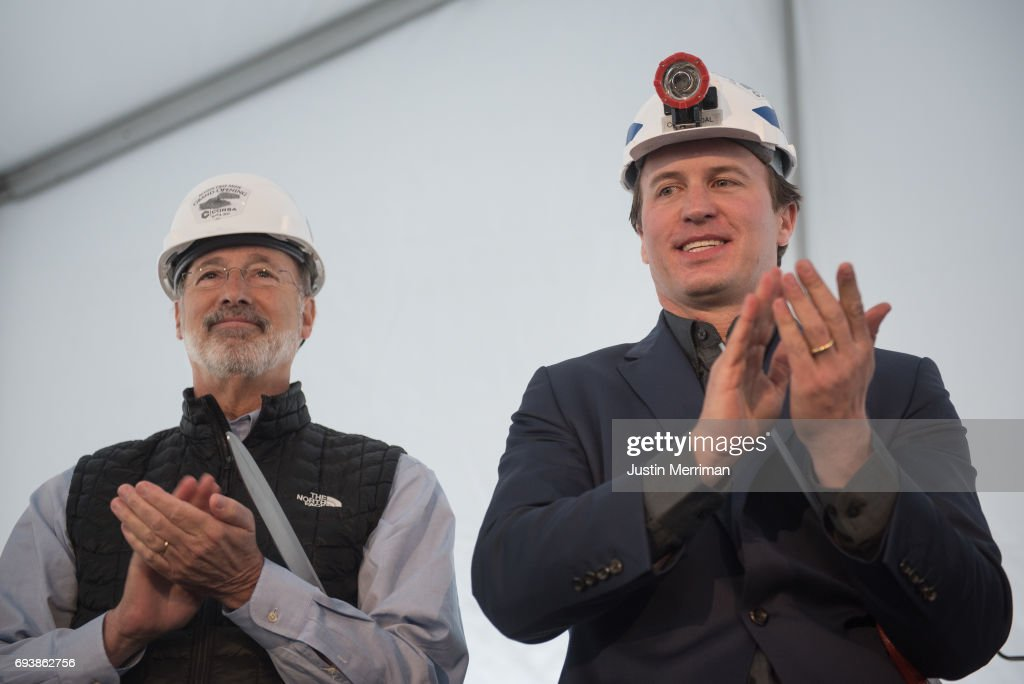 George Dethlefsen, CEO Corsa Coal Corp., right, stands with Pennsylvania Governor Tom Wolf after they cut the ribbon at the grand opening of Corsa Coal's Acosta Deep Mine on June 8, 2017 in Friedens, Pennsylvania. The mine is expected to create more than 70 new jobs and should produce 400,000 tons of metallurgical coal a year.