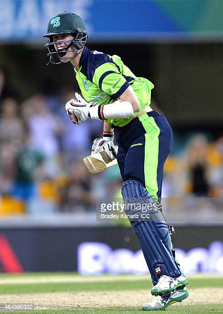George Dockrell of Ireland celebrates victory after the 2015 ICC Cricket World Cup match between Ireland and the United Arab Emirates at The Gabba on...
